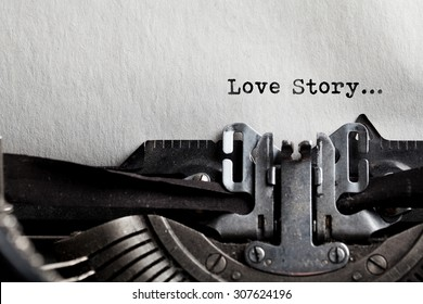 typewriter with white paper. love story sign