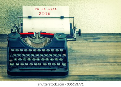 Typewriter with white paper page on wooden table. sample text  To Do List 2016. Vintage style toned picture