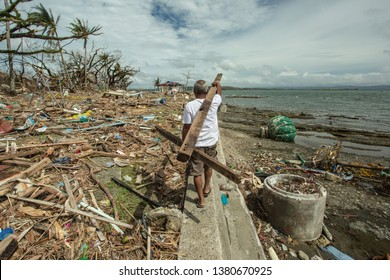 Typhoon Haiyan Wood Gathering for rebuilding, Cross shadow