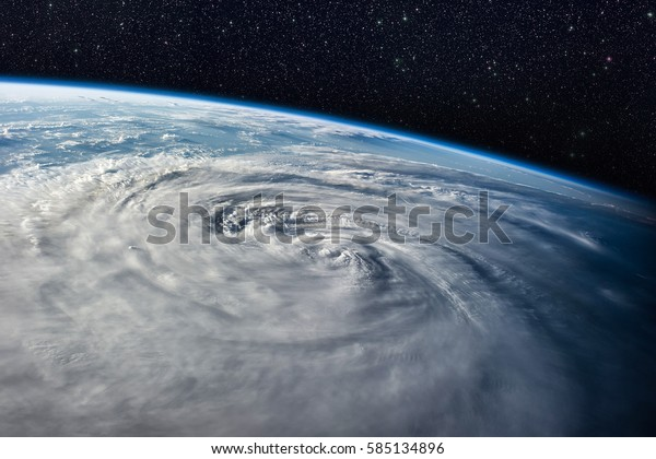 Typhoon over planet Earth - satellite photo. Elements of this image furnished by NASA.