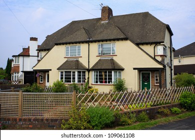 Typical 1930s cream colored semi detached house with Bay Window, in Bristol, England