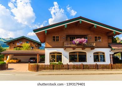 Typical alpine houses in countryside landscape near Kitzbuhel town, Tirol, Austria