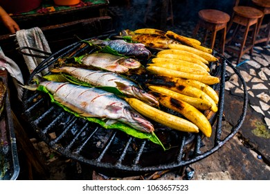 Typical Amazonian, Peruvian lunch made on the grill, with fish and bananas in Iquitos, Peru, South America