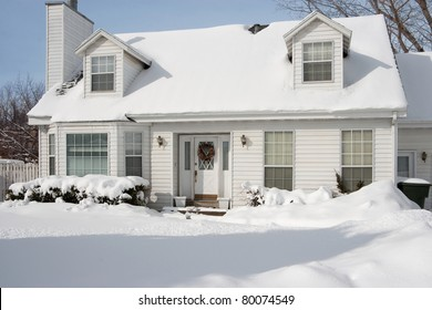 Typical American home in winter - new snow - cape cod style
