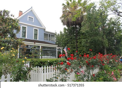 Typical American House, Blue with Picket Fence