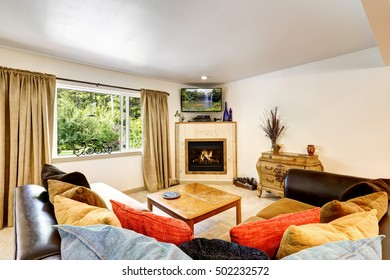 Typical American living room interior with fireplace and retro style furniture. Northwest, USA