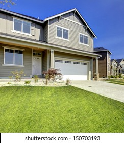 Typical American Northwest style new development house exterior. Natural colors, simple build 3-4 bedrooms homes. First time home owners great deal.