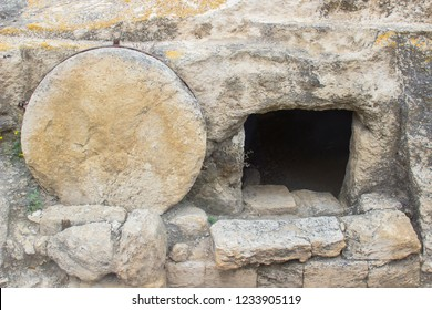 A typical ancient rock hewn sepulchre on the road to Megiddo in Israel. This is an example of the type of tomb Jesus Christ was buried in by his disciples