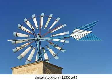Typical ancient windmill in Majorca rural side