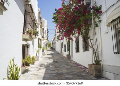 typical Andalusian streets and balconies with flowers in Marbella Andalucia Spain