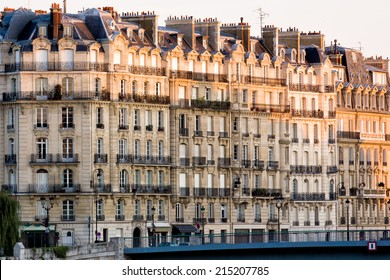 Typical apartment buildings at the quay of the river Seine in Paris, capital of France, in the early morning catching the first sunshine of the day