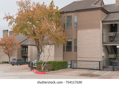 Typical apartment complex building in suburban area at Irving, North Texas, USA during fall season.
