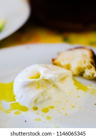 Typical Apulian dish with fresh burrata cheese, olive oil and bread for tasting.