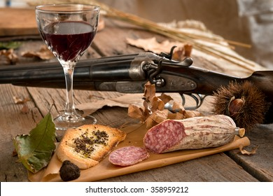 The typical autumn food of the italian hunting tradition, especially in Tuscany, greeting card, Italy