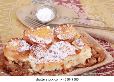 A typical baked cake from the Czech Republic with cheese, apples, eggs and bread with a name Zemlovka or Zemlbaba.
