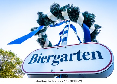 typical bavarian maypole - closeup - photo - translation: beergarden
