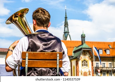 typical bavarian musician in front of old town - bad toelz