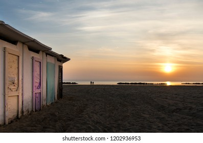 Typical beach of the Adriatic Sea with old colored cabins. Photograph taken at sunrise