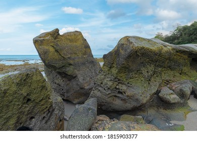Typical Beach Rock Structure, made up of big black Basaltic and Igneous Rocks on coastline. Being eroded from centuries by waves, these act as habitat of moisture loving organisms as lichens etc.