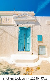 Typical blue door in Emporio on the island of Santorini, Greece. Retro toned