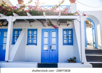 Typical blue door with stairs. Santorini island, Greece