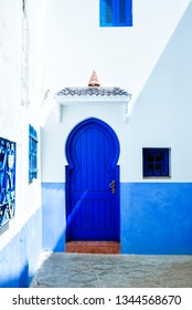 Typical blue house door in Chefchaouen, Morocco.