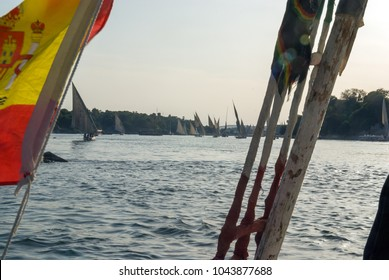 Typical boats of the Nile river called felucca seen from one of them with the Spanish flag