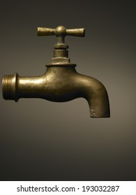 typical brass faucet on brown background gradient