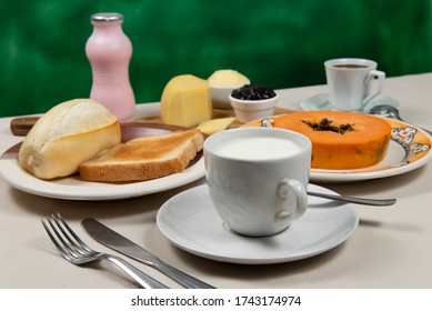 typical Brazilian breakfast with coffee, cup of milk and bread