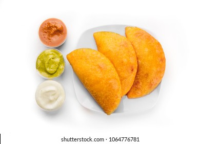 Typical breakfast in Latin America, empanadas with different types of sauces