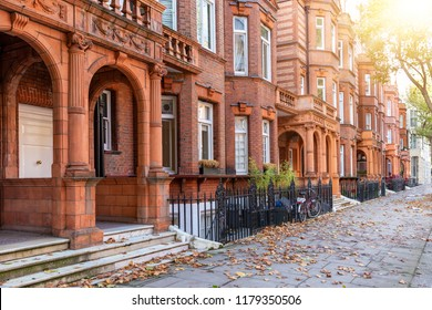 Typical, British Georgian houses in London, Kensington district, during autumn time with golden sunshine