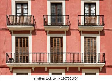 Typical building facade with balconies in Tarragona, Spain