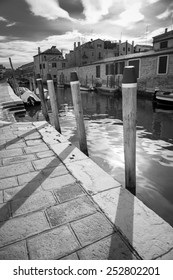 Typical canal bank with mooring poles, Venice, Italy