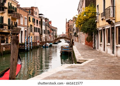 Typical canal of Venice with boats, old houses and bridges