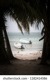 Typical carribean beach with fishing boats during tropical storm