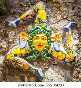 A typical ceramic Trinacria, the symbol of Sicily, hung along the streets of Taormina.