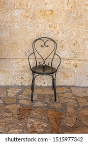 Typical chair in front of the wall of a farmhouse