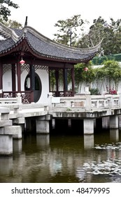 A typical Chinese garden with a pond.