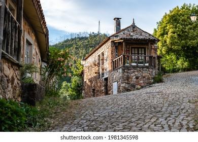 Typical cobbled street with famous schist houses in the village of Casal de São Simão, Figueiró dos Vinhos PORTUGAL