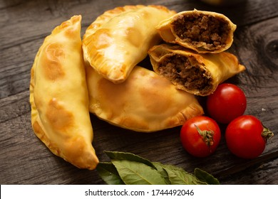 Typical Colombian empanada stuffed with meat and tomatoes, fast food