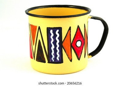 A typical colorful African tin coffee cup isolated on white background
