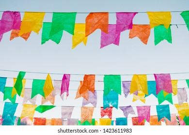 Typical colorful flags used for decoration at the June Festivals (aka festas de Sao Joao), with copy space