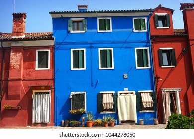 typical colorful houses in Burano, Venice, Italy. Burano is a small island in the Venetian Lagoon