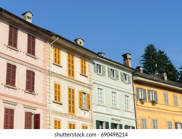 Typical colorful houses at the main square on a sunny evening in San Guillio di Orta, Italy