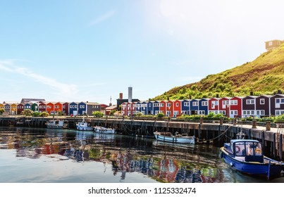 typical colorful houses at waterfront on Helgoland island on sunny day