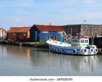 Typical colorful wood huts in Oleron island, France