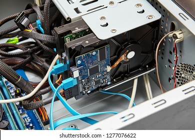 Typical connection of a hard drive using SATA cables, blue cable is SATA data, and the connector from below is the power SATA cable.