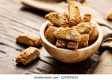 Typical cookies of Tuscany cantucci on the wooden table, selective focus
