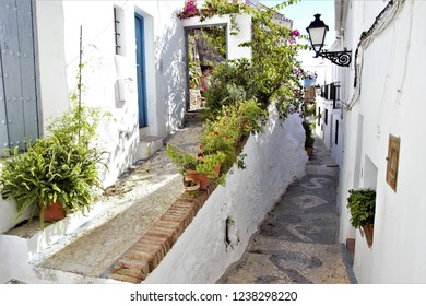 typical corners of the Andalusian village of Frigiliana, tourist destination, white village of Málaga, in the Mediterranean, typical constructions of the white villages of Andalusia, Spain,