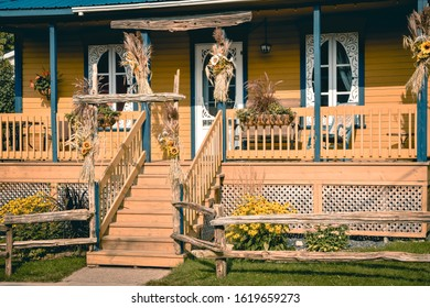 Typical country porched house in orange and blue. Canada. Rural life concept.